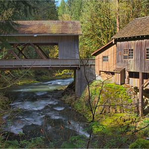 A covered bridge and a grist mill.